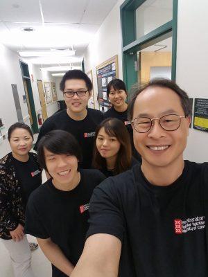Lab members in a hallway taking a selfie